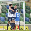 Party crasher: Johnny Lafferty celebrates his winner for Ballinamallard United at Windsor Park