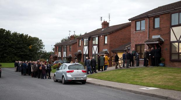 Mourners queue to pay their respects at Garda Tony Golden's home in Blackrock, Co Louth