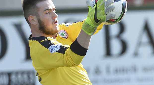 Safe hands: Peter Burke was Cliftonville's penalty hero