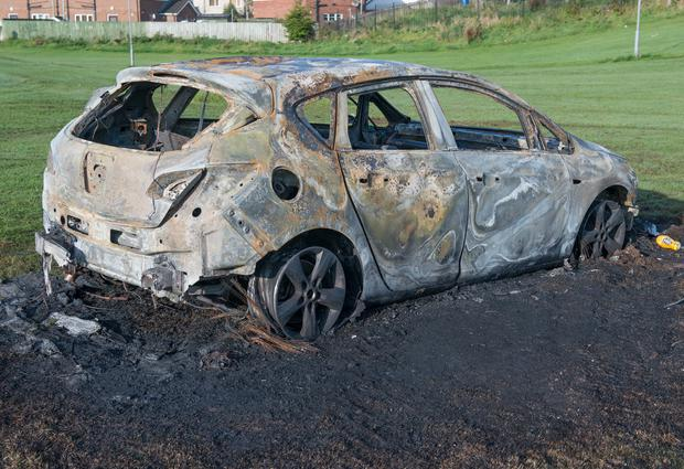 The burnt out shell of the car belonging to Emma Logue whose depends on it to take her son Fionn, who has cerebral palsy, to hospital. PIcture: Martin McKeown. Inpresspics.com. 14.10.15