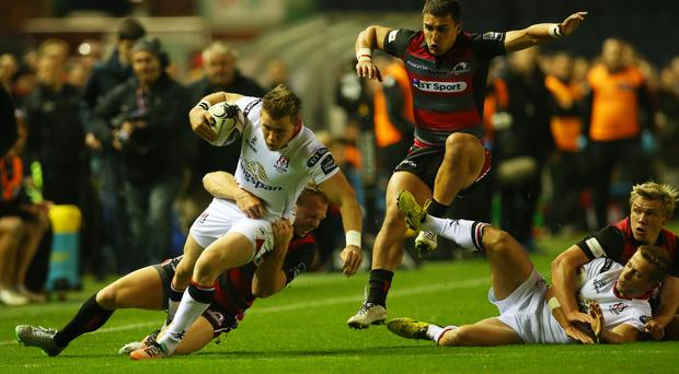 Stopped in his tracks: Ulster's Craig Gilroy is halted by John Andress of Edinburgh at Murrayfield