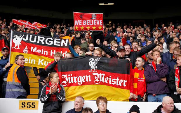 Liverpool supporters hold up banners in support of their new manager, Liverpool's German manager Jurgen Klopp ahead of the English Premier League football match between Tottenham Hotspur and Liverpool at White Hart Lane in north London on October 17, 2015. AFP PHOTO / IAN KINGTON