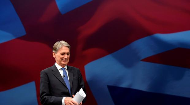 Foreign Secretary Philip Hammond faces calls to intervene to stop the disciplinary process. Stefan Rousseau/PA Wire