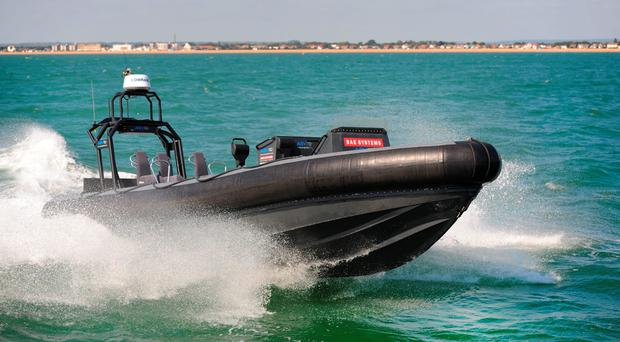 BAE Systems undated handout photo of its high-tech 'drone' boat capable of being operated for 12-hour autonomous and unmanned surveillance missions which is being developed for the Royal Navy's new aircraft carrier. BAE Systems/PA Wire.