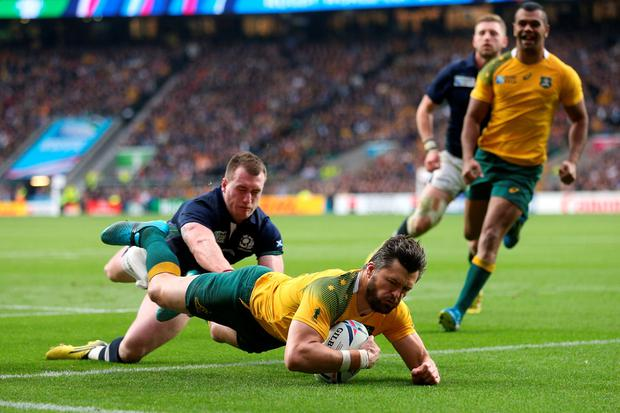 Australia's Adam Ashley-Cooper scores their fourth try during the Rugby World Cup match at Twickenham Stadium, London. David Davies/PA Wire.