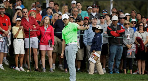 Rory McIlroy reacts after missing a birdie putt on the second green of the Silverado Resort North Course during the third round of the Frys.com golf tournament Saturday, Oct. 17, 2015, in Napa, Calif. (AP Photo/Eric Risberg)