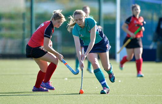 All action: Amy Cross of Carrickfergus beats Amanda Nicholl of Limavady to the ball