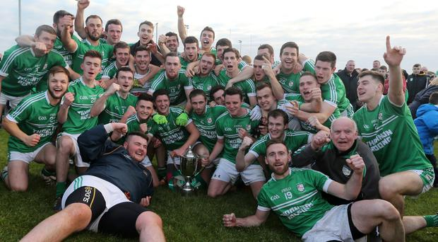 Start the party: Cargin celebrate their Antrim Senior Championship win over Lamh Dhearg
