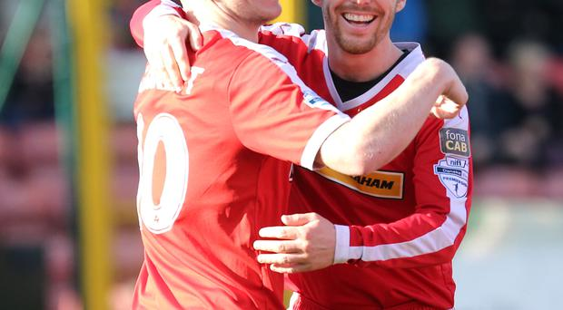 Well connected: Stephen Garrett (left) celebrates his double