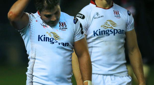 Dejected: Sam Arnold and Andrew Trimble trudge off after defeat in Edinburgh