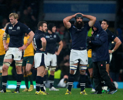 Devastated: Richie Gray, Greig Laidlaw and Josh Strauss can't believe Scotland's agonising last-gasp quarter-final loss to Australia