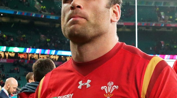 A dejected Jamie Roberts leaves the field after the defeat to South Africa
