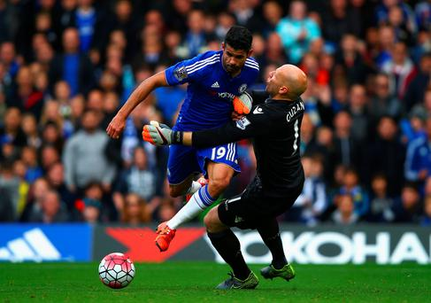 Battle: Diego Costa takes on Aston Villa keeper Brad Guzan