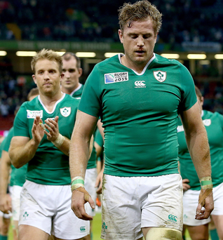 Blown away: Ireland players trudge off the Millennium Stadium after a bad loss to Argentina