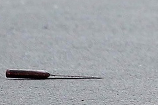 A knife left lying at the scene of a triple stabbing.