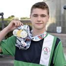 Treble yell: Conor Ferguson shows off the three medals he won at the Commonwealth Youth Games