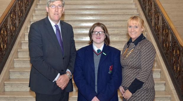 Wellington College pupil Kathryn Gray, who was the top maths GCSE student in Northern Ireland, with the college's principal Nicola Connery and Education Minister John O'Dowd