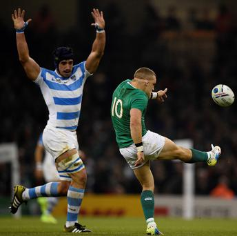 World of trouble: Ian Madigan attempts a kick against Argentina