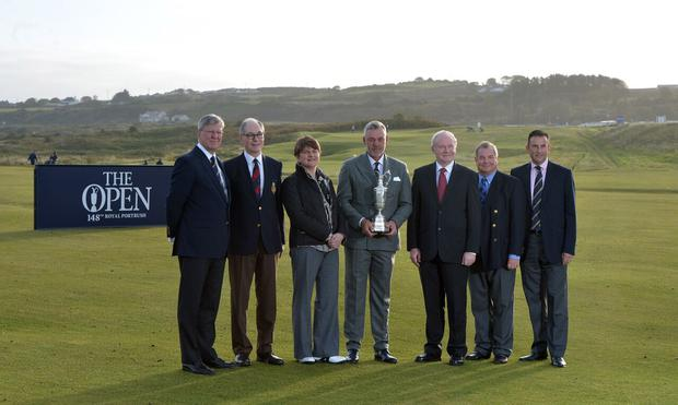 (L-R) Martin Slumbers, Chief Executive of The R&A, Sir Richard McLaughlin, Captain of Royal Portrush Golf Club, Acting First Minister the Rt. Hon. Arlene Foster MLA, Darren Clarke, Champion Golfer of the Year at Royal St Georges in 2011 and a member at Royal Portrush, Deputy First Minister Martin McGuinness MLA, Peter Unsworth, Chairman of The R&As Championship Committee, and Martin Ebert, Course Architect pose with the Claret Jug at the announcement that The Open will return to Royal Portrush in 2019. Photo: R&A