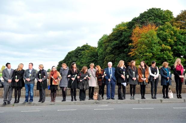 Teachers from the school of Jodie White, aged 9 line the street in mourning at the funeral of a young family killed in a fire being held at the Church of The Most Holy Redeemer on October 20, 2015 in Bray, Ireland. It is the first of the funerals for 10 people who lost their lives at a traveller halting site in Carrickmines on October 10. The 5 being buried today are Willie Lynch (25), his partner Tara Gilbert (27) and their children Jodie (9) and Kelsey (4) and Willie's brother, Jimmy Lynch (39). (Photo by Clodagh Kilcoyne/Getty Images)