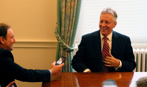 DUP Leader Peter Robinson in his office in Stormont in Belfast gives his reaction in the wake of the publication of a Government-ordered review of paramilitary structures in Northern Ireland. Photo: PA