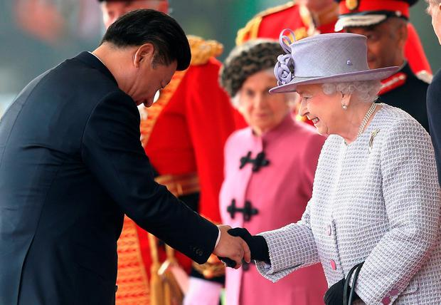Britain's Queen Elizabeth II (R) shakes hands with China's President Xi Jinping (L) on Horse Guards Parade in central London on October 20, 2015, during Xi's ceremonial welcome on the first official day of a state visit. Chinese President Xi Jinping arrived for a four-day state visit as the government of Prime Minister David Cameron seeks stronger trade ties with the world's second-largest economy. AFP PHOTO / POOL / CHRIS JACKSONChris Jackson/AFP/Getty Images