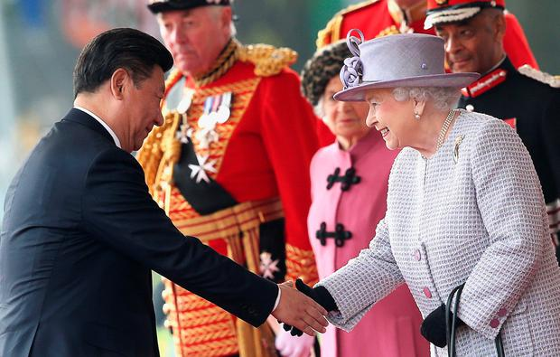 Britain's Queen Elizabeth II (R) shakes hands with China's President Xi Jinping (L) at the royal pavilion on Horse Guards Parade in central London on October 20, 2015, during Xi's ceremonial welcome on the first official day of a state visit. Chinese President Xi Jinping arrived for a four-day state visit as the government of Prime Minister David Cameron seeks stronger trade ties with the world's second-largest economy. AFP PHOTO / POOL / CHRIS JACKSONChris Jackson/AFP/Getty Images