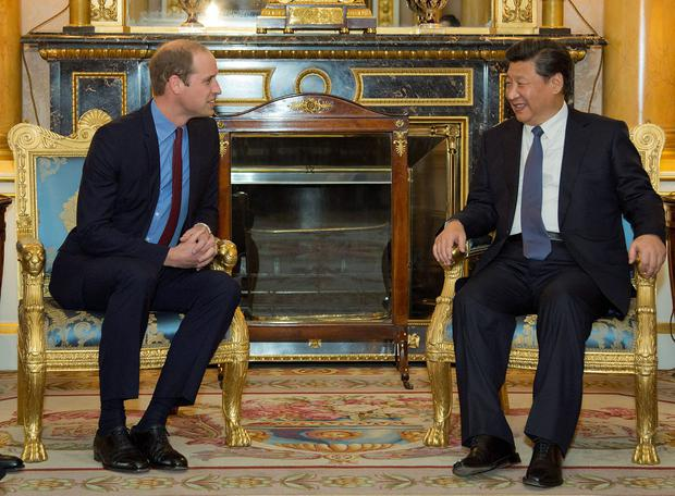 Britain's Prince William, Duke of Cambridge, (L) meets with China's President Xi Jinping at Buckingham Place in London on October 20, 2015, on the first official day of a state visit. Chinese President Xi Jinping arrived for a four-day state visit as the government of Prime Minister David Cameron seeks stronger trade ties with the world's second-largest economy. AFP PHOTO / YUI MOK / POOLYUI MOK/AFP/Getty Images