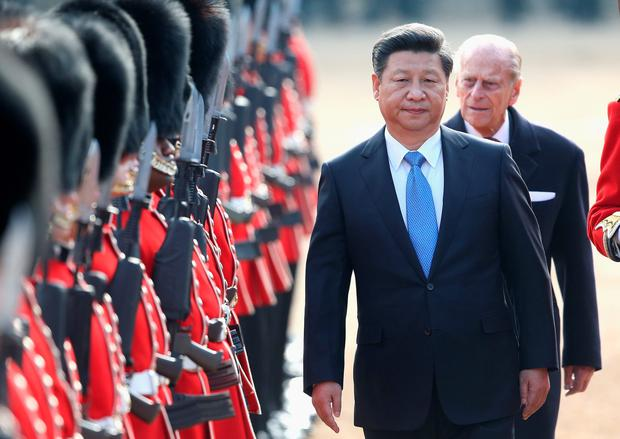 The Duke of Edinburgh accompanies Chinese President Xi Jinping (left), as he inspects a Guard of Honour during the ceremonial welcome on Horse Guards Parade, London, for the President on the first day of his state visit to the UK. PRESS ASSOCIATION Photo. Picture date: Tuesday October 20, 2015. See PA story ROYAL China. Photo credit should read: Chris Jackson/PA Wire