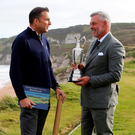 Making history: Darren Clarke and course designer Martin Ebert at Portrush yesterday