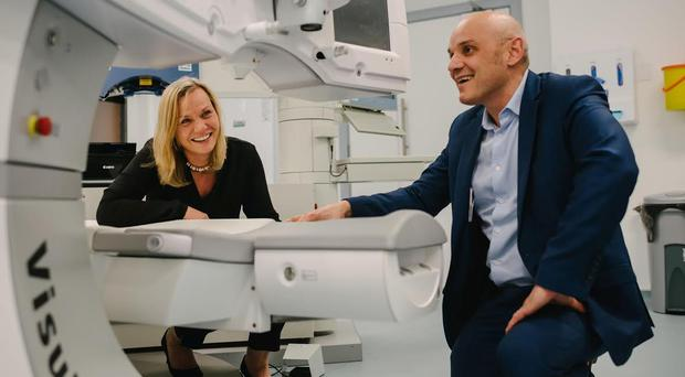 Sheena Maxwell and Professor Johnny Moore, Medical Director, Cathedral Eye Clinic inspect the new Visumax laser technology recently installed in the new Cathedral Eye Clinic. (Brideen Baxter, Simple Tapestry)
