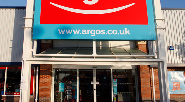 Argos has seen its first half earnings nearly halved