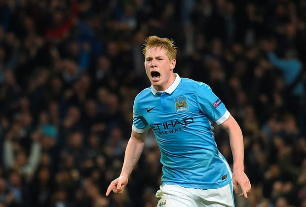 Manchester City's Belgian midfielder Kevin De Bruyne celebrates after scoring during a UEFA Champions league Group D football match between Manchester City and Sevilla at the Etihad Stadium in Manchester, north west England on October 21, 2015. AFP/Getty Images