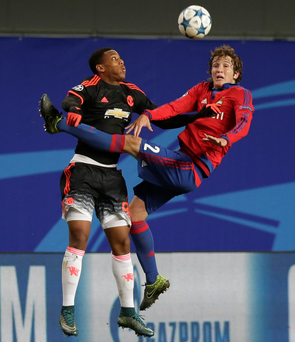 Heads up: Manchester United's Anthony Martial, left, jumps for a header with Mario Fernandes