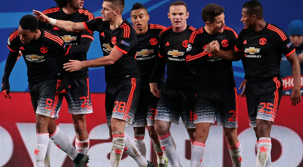 Well done son: Manchester United players congratulate Anthony Martial (far left) after his equaliser against CSKA Moscow