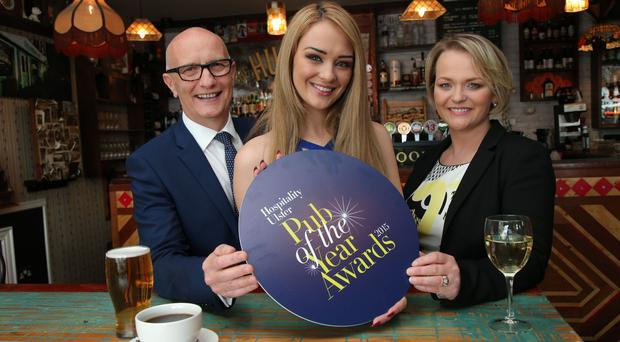 Hospitality Ulster chief executive Colin Neill, model Ashleigh Coyle and Olga Walls of Hospitality Ulster unveil the shortlist for the Ulster Pub of the Year awards. Pic: Presseye.