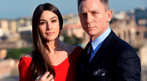 Monica Bellucci and British actor Daniel Craig posing during a photocall to promote the 24th James Bond film 'Spectre' at Rome's city hall.