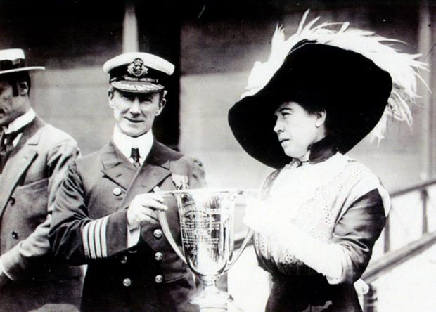 Undated handout photo issued by Henry Aldridge & Son courtesy of the Titanic Museum Branson, USA, of a cup being presented by Titanic survivor Margaret Brown to the captain of rescue ship Carpathia, which is expected to sell for more than £50,000 at auction. PA