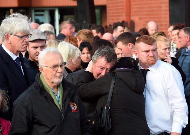 Mourners at the funeral of the Connors family, Thomas, 27, and his wife Sylvia, 25, with three of their children, Jim, five, Christy, at the Church of the Ascension of the Lord in Balally, Co Dublin, who died in the fire at Carrickmines, south Dublin. PA