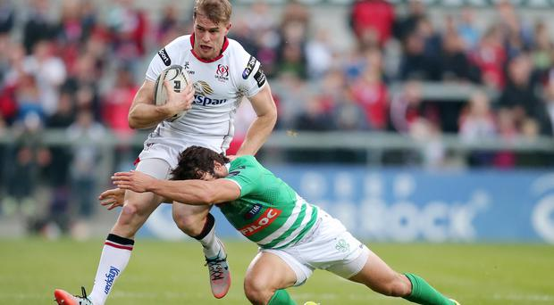 2 October 15 - Picture by Darren Kidd / Press Eye. Guinness Pro12: Ulster v Benetton Treviso, Kingspan Stadium, Belfast. Ulster's Andrew Trimble is tackled by Treviso's Ludovico Nitoglia
