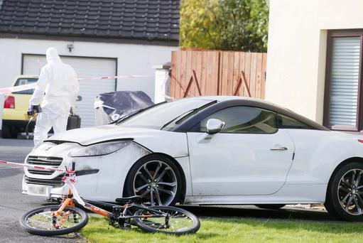 The scene at Larchwood Court in Banbridge, Co. Down, where one car was set on fire and another attempted attack on a second car at the same property. Incendiary devices were used in the attack which happened in the early hours of Friday morning. Press Eye - Belfast - Northern Ireland - 23rd October 2015 Picture by Jonathan Porter/PressEye
