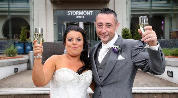 22 October 15 - Picture by Darren Kidd / Press Eye. *** NO FEE ISSUED ON BEHALF OF HASTINGS HOTELS**** Newlyweds Neil and Leonie McCluskey were pictured yesterday (Friday) arriving at the Stormont Hotel for their wedding reception. Earlier this week the couple found out that their original wedding venue, the Portaferry Hotel, had closed and with just 48 hours to go, the Stormont Hotel stepped in and offered the couple the fabulous 4-star venue as a replacement for their big day.
