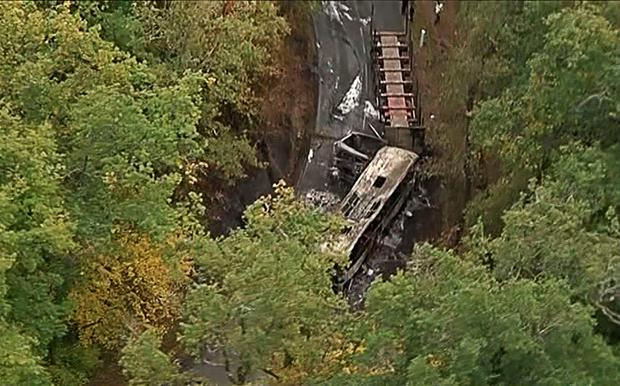 This video grab taken from footage obtained from French TV news channel BFM TV shows the wreckage of a coach carrying elderly day-trippers (L) that collided with a lorry. AFP/Getty Images