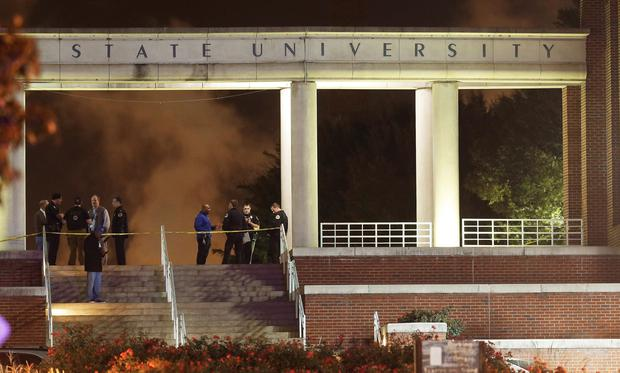 Officials investigate the scene of a shooting on the campus of Tennessee State University in Nashville, Tenn. (AP Photo/Mark Humphrey)