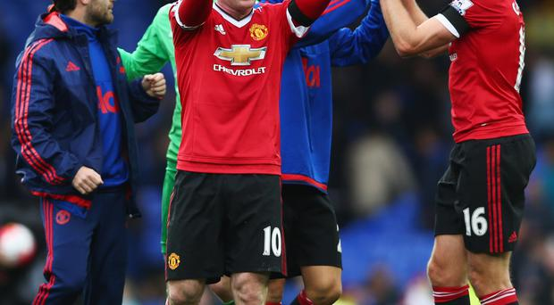 Raring to go: Louis van Gaal is hoping Wayne Rooney can explode into life in the derby