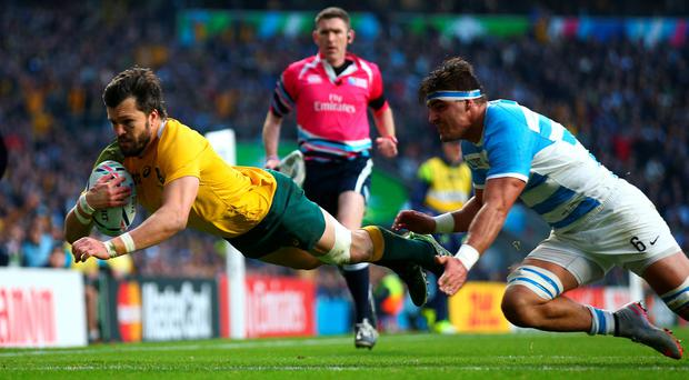 Adam Ashley-Cooper of Australia scores his sides second try during the 2015 Rugby World Cup Semi Final match between Argentina and Australia at Twickenham Stadium on October 25, 2015 in London, United Kingdom. (Photo by Paul Gilham/Getty Images)