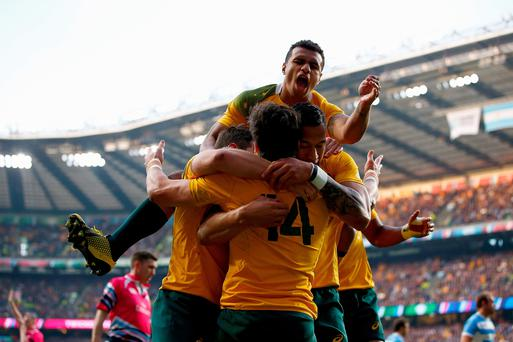 Adam Ashley-Cooper of Australia celebrates with teammates after scoring his sides second try during the 2015 Rugby World Cup Semi Final match between Argentina and Australia at Twickenham Stadium on October 25, 2015 in London, United Kingdom. (Photo by Dan Mullan/Getty Images)