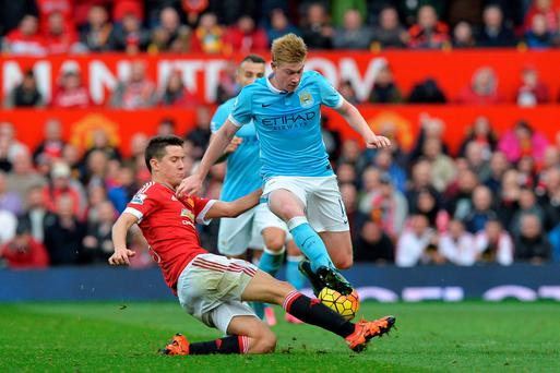 Manchester United's Ander Herrera and Manchester City's Kevin de Bruyne (right) battle for the ball during the Barclays Premier League match at Old Trafford, Manchester. Martin Rickett/PA Wire.