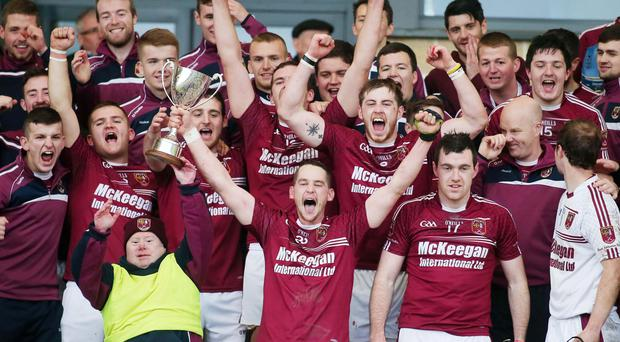 Glory boys: Cushendall players get the party started