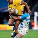 Up close: Kurtley Beale is tackled by Juan Martin Fernandez Lobbe